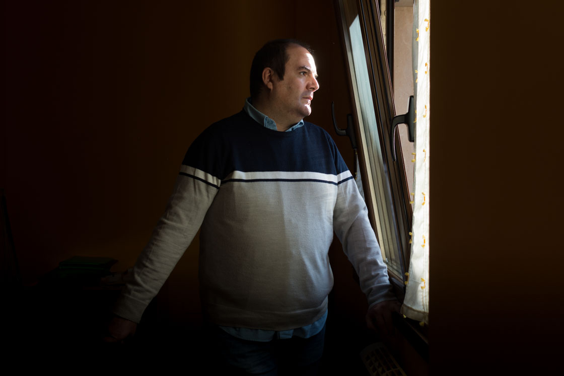 Andrés Colao, spokesperson for a Spanish charity related to mental health, stares through a window